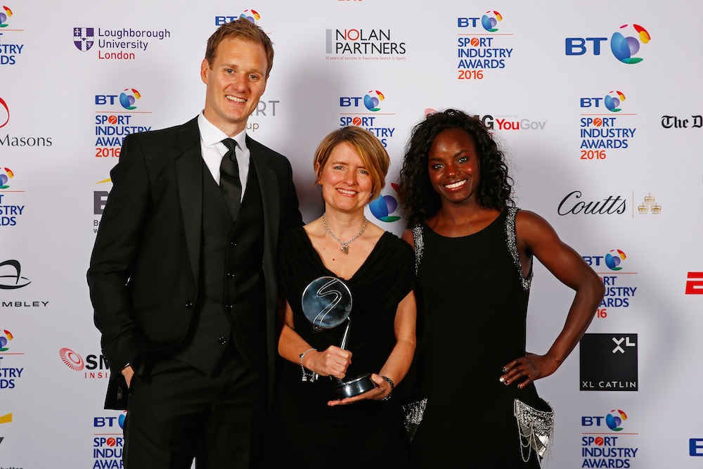 LONDON, ENGLAND - APRIL 28: Eniola Aluko and Dan Walker present the Leadership in Sport Award award in association with Nolan Partners to Kelly Simmons at the BT Sport Industry Awards 2016 at Battersea Evolution on April 28, 2016 in London, England. The BT Sport Industry Awards is the most prestigious commercial sports awards ceremony in Europe, where over 1750 of the industry's key decision-makers mix with high profile sporting celebrities for the most important networking occasion in the sport business calendar. (Photo by Christopher Lee/Getty Images for BT Sport Industry Awards) *** Local Caption *** Eniola Aluko; Dan Walker; Kelly Simmons
